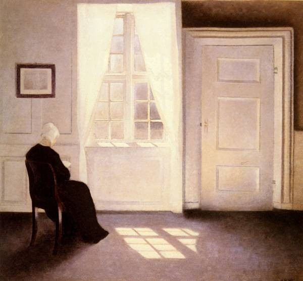 A Woman Reading By A Window